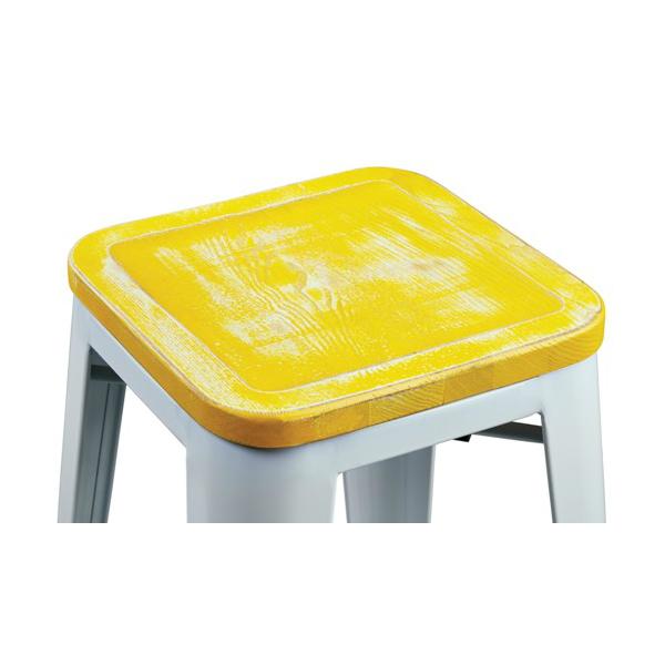 white tolix bar stool with yellow weathered seat hospitality